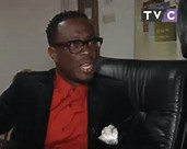julius agwu granting an interview with tvc