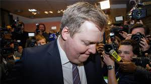 Iceland Prime Minister bends his head in shame after he announced his retirement from office last week.