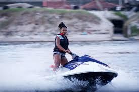 a girl on a jet ski